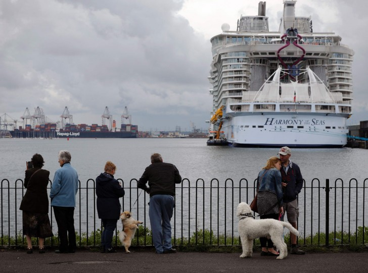 People wait to see the Harmony of the Seas cruise ship set sail from Southampton, southern England, on May 22, 2016. (ADRIAN DENNIS/AFP/Getty Images)