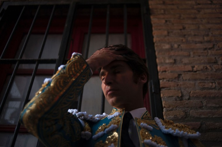 "Spanish matador Cayetano Rivera prepares himself before a ""corrida"" (bullfight) during the Corpus bullfighting festival at the bullring of Granada on May 25, 2016. (JORGE GUERRERO/AFP/Getty Images)"