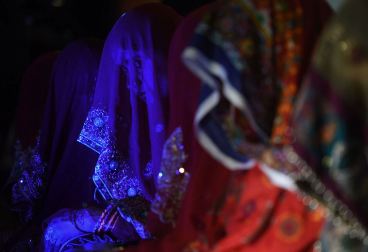 Pakistani brides attend a mass-wedding ceremony in Karachi late May 9, 2016. (ASIF HASSAN/AFP/Getty Images)