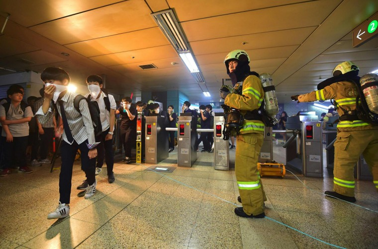 South Korean students participate in a fire drill as part of a disaster management exercise at a subway station in Seoul on May 16, 2016. (JUNG YEON-JE/AFP/Getty Images)