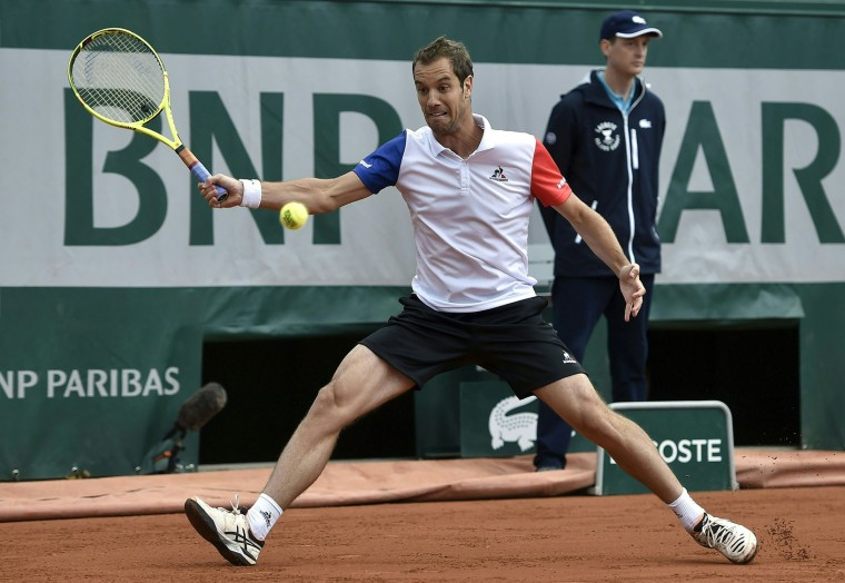 France's Richard Gasquet returns the ball to Brazil's Thomaz Belluci during their men's first round match at the Roland Garros 2016 French Tennis Open in Paris on May 23, 2016. (Eric Feferberg/AFP/Getty Images)