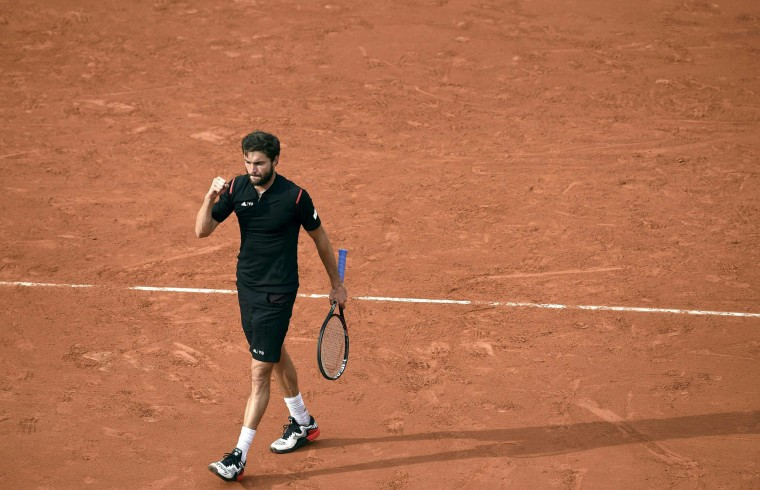 France's Gilles Simon celebrates after winning his men's first round match against Brazil's Rogerio Dutra Silva at the Roland Garros 2016 French Tennis Open in Paris on May 23, 2016. (Eric Feferberg/AFP/Getty Images)