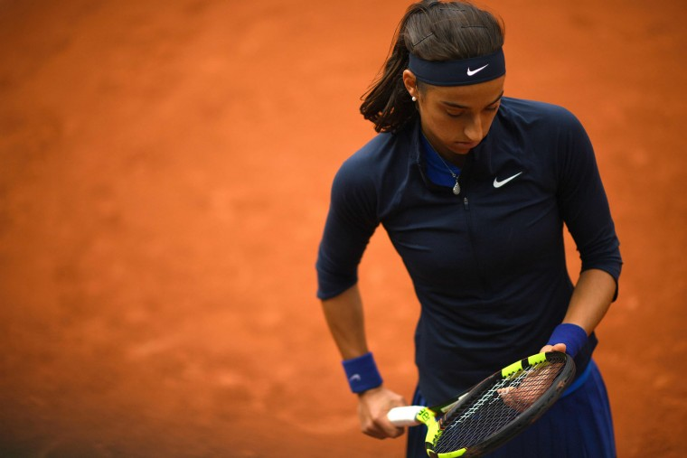 France's Caroline Garcia looks at her racket during her women's first round match against Ukraine's Lesya Tsurenko at the Roland Garros 2016 French Tennis Open in Paris on May 23, 2016. (Martin Bureau/AFP/Getty Images)