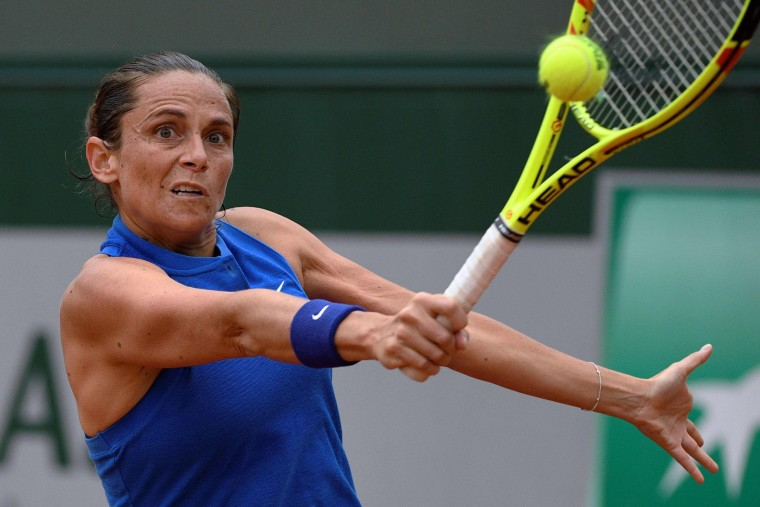 Italy's Roberta Vinci returns the ball to Ukraine's Kateryna Bondarenko during the women's first round match at the Roland Garros 2016 French Tennis Open in Paris on May 23, 2016. (Martin Bureau/AFP/Getty Images)