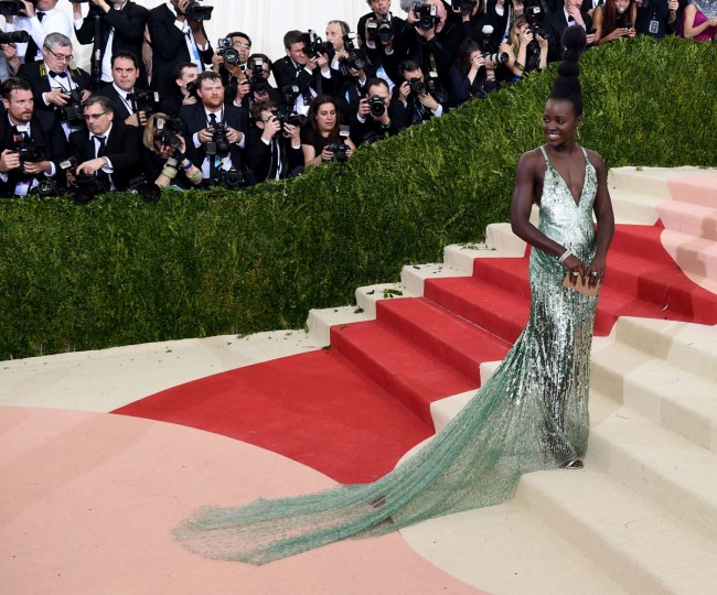 Lupita Nyongo arrives for the Costume Institute Benefit at The Metropolitan Museum of Art May 2, 2016 in New York. / AFP PHOTO / TIMOTHY A. CLARYTIMOTHY A. CLARY/AFP/Getty Images