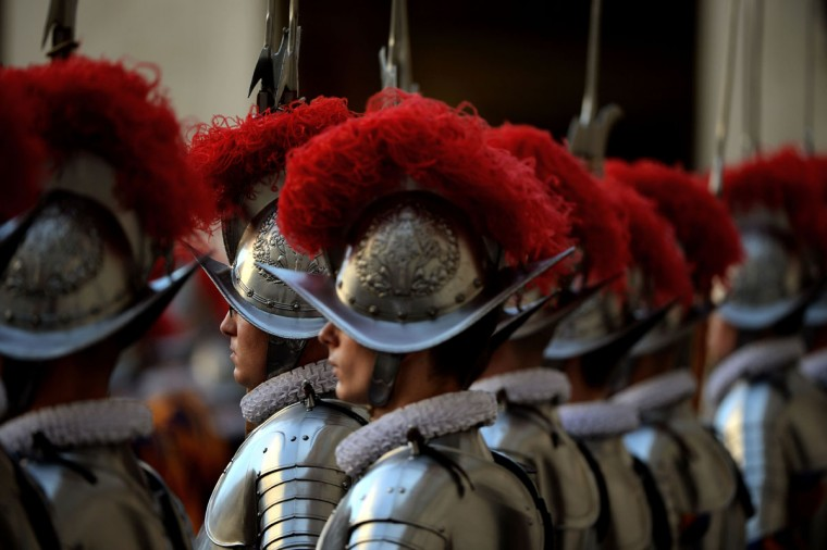 New swiss guards stand duirng a swearing-in ceremony in Vatican City, on May 6, 2016. The annual swearing in ceremony for the new papal Swiss guards takes place on May 6, commemorating the 147 who died defending Pope Clement VII on the same day in 1527 during the sack of Rome. (AFP Photo/Filippo Monteforte)