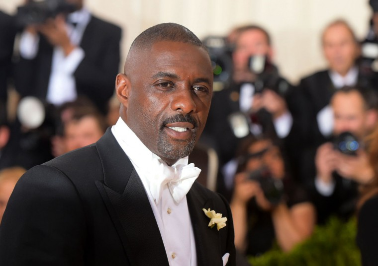 "Idris Elba arrives at The Metropolitan Museum of Art Costume Institute Benefit Gala, celebrating the opening of ""Manus x Machina: Fashion in an Age of Technology"" on Monday, May 2, 2016, in New York. (Photo by Charles Sykes/Invision/AP)"