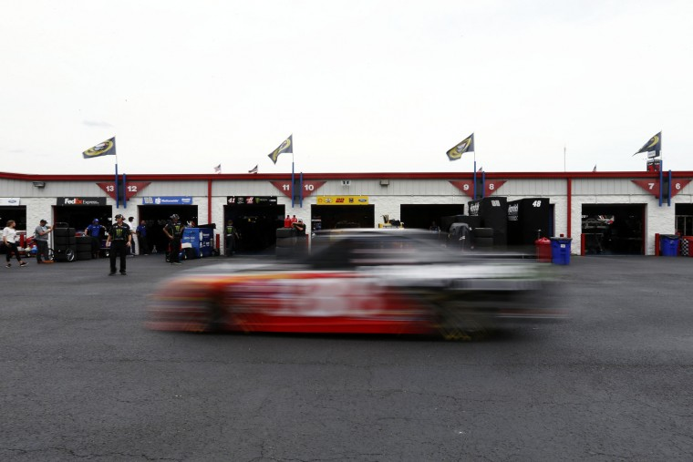 Landon Cassill drives into the garage area after practicing for Sunday's NASCAR Sprint Cup auto race at Talladega Superspeedway, Friday, April 29, 2016, in Talladega, Ala. (AP Photo/Brynn Anderson)