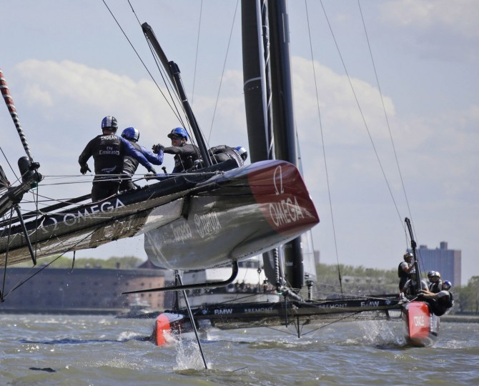 The crew of Emirates Team New Zealand, left, celebrates as they finish in front of Oracle Team USA during Race 3 of the America's Cup World Series sailing event in New York, Sunday, May 8, 2016. Emirates Team New Zealand won the N.Y. event. (AP Photo/Seth Wenig)
