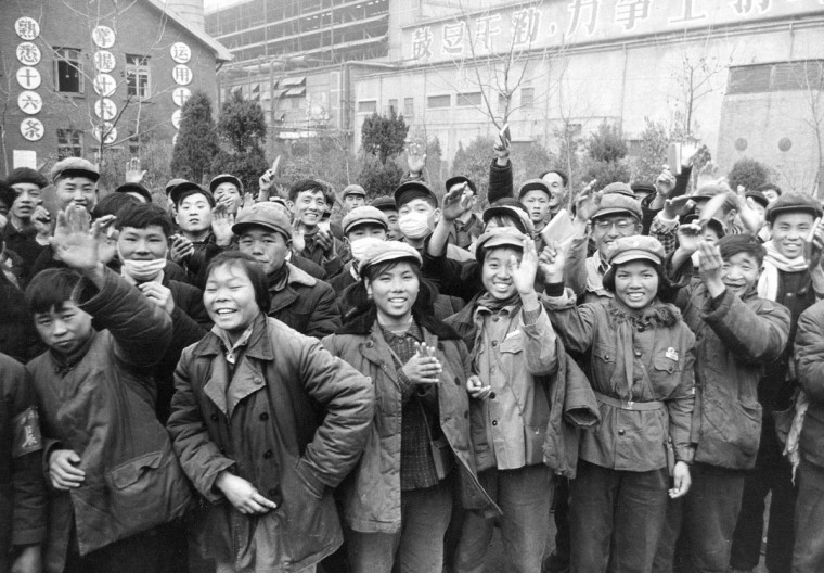 In this Jan. 23, 1967 photo, young Chinese gathered outside a factory wave copies of the collected writings of Communist Party Chairman Mao Zedong, often referred to as Mao's Little Red Book. Monday, May 16, 2016 marks the 50th anniversary of a 1966 party meeting that spearheaded the 10-year Cultural Revolution, a violent and frequently chaotic attempt by Mao to reassert his power and revive his party's egalitarian ideals. (AP Photo, File)