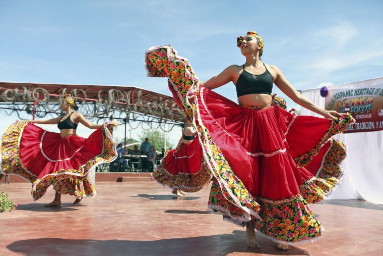 Minerva Allende, right, dances with her fellow dancers of Cuerpo Escena Comania de Danza from the Institute of Chihuahua in celebration of Cinco de Mayo at the LULAC/Hispanic Heritage of Odessa's annual Fiesta Lunch at the La Margarita Festival Grounds, Thursday, May, 5, in Odessa, Texas. (Jacob Ford/Odessa American via AP)