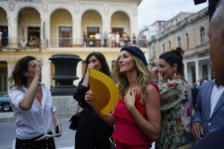 "Brazilian top model Gisele Bundchen, second right, attends the presentation of fashion designer Karl Lagerfeld's ""cruise"" line for fashion house Chanel, at the Paseo del Prado street in Havana, Cuba, Tuesday, May 3, 2016. With the heart of the Cuban capital effectively privatized by an international corporation under the watchful eye of the Cuban state, the premiere of Chanel 2016/2017 ""cruise"" line offered a startling sight in a country officially dedicated to social equality and the rejection of material wealth. (AP Photo/Ramon Espinosa)"