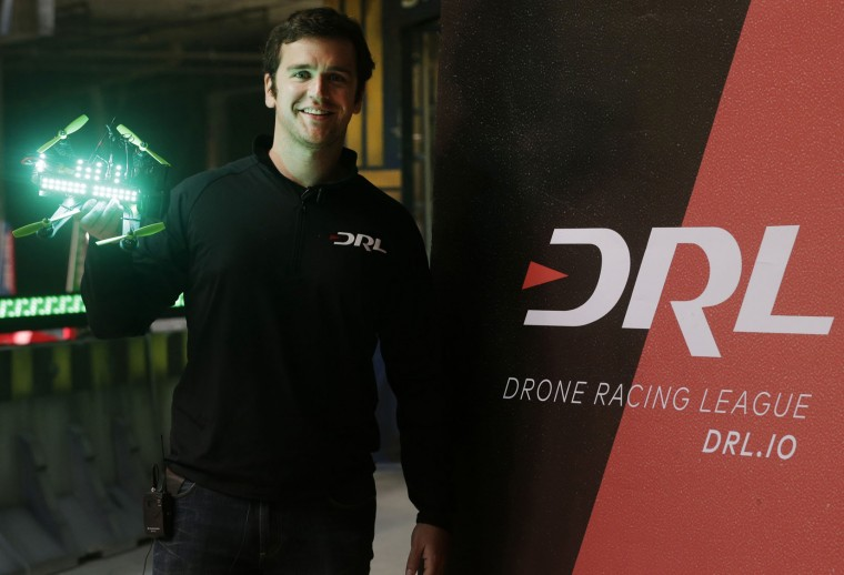 "In this March 18, 2016, photo, Drone Racing League founder and CEO Nicholas Horbaczewski holds a racing drone, in a vacant mall in Hawthorne, Calif. Horbaczewski is betting he can the transform drone racing from a throw-down among hobbyists into a mainstream spectacle. ""To translate from a participatory sport to a professional sport that has a widespread audience, you have to put a lot of thought into how you're going to do that. And that's what we really focus on here at DRL,"" he said. (AP Photo/Nick Ut)"