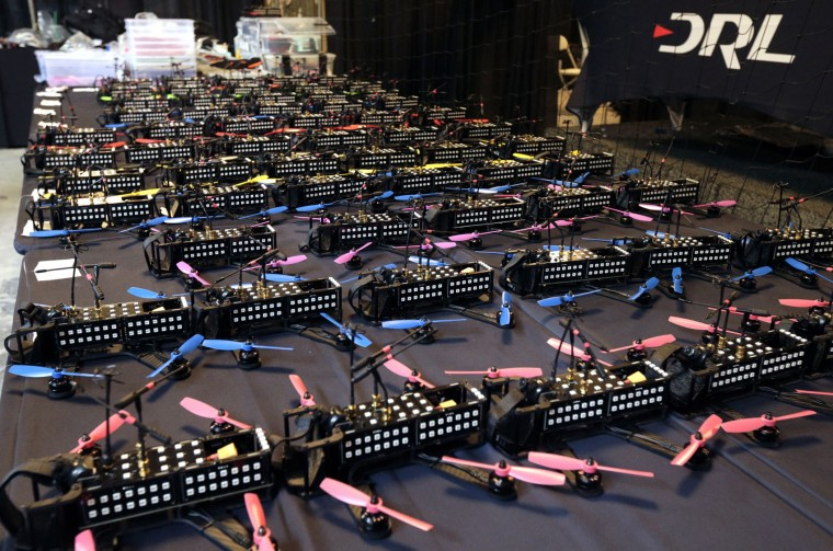 This Friday, March 18, 2016, photo shows drones readied prior to races held by the Drone Racing League at a vacant mall in Hawthorne, Calif. In drone racing, a crash means bits of plastic go flying, a replacement is grabbed, and no harm done. For now, bragging rights are the main stakes. Drone racing leagues would love to follow sports like poker into the mainstream with big TV audiences and sponsorships. But getting sponsors and fans is also a race against time. (AP Photo/Nick Ut)