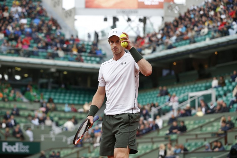 Britain's Andy Murray holds two balls prior to serving in his first round match of the French Open tennis tournament against Radek Stepanek of the Czech Republic at the Roland Garros stadium in Paris, France, Monday, May 23, 2016. (AP Photo/Alastair Grant)