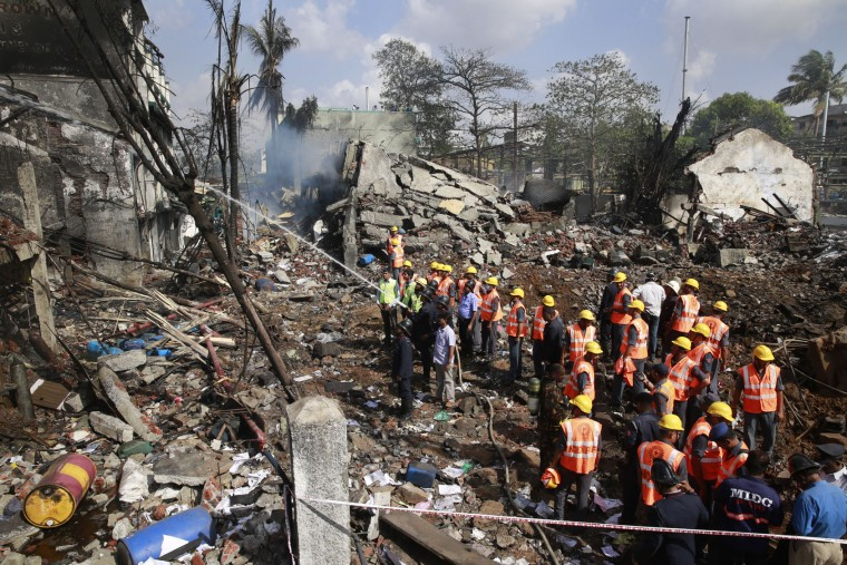 Indian fire fighters and rescue personnels work at the site of an explosion at a chemical factory in Dombivli, in the outskirts of Mumbai, India, Thursday, May 26, 2016. The powerful explosion shattered windows in buildings near the factory. (AP Photo/Rafiq Maqbool)