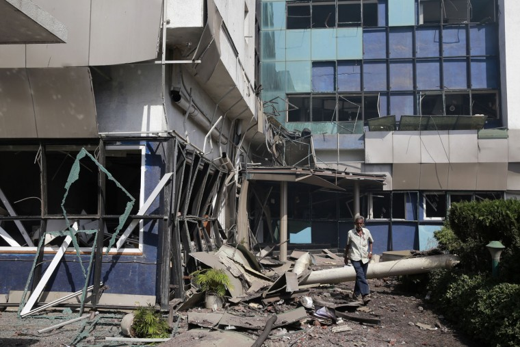 A man comes out of a damaged building after an explosion at a chemical factory in Dombivli, in the outskirts of Mumbai, India, Thursday, May 26, 2016. The powerful explosion shattered windows in buildings near the factory. (AP Photo/Rafiq Maqbool)
