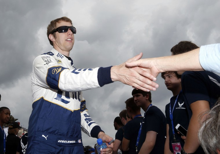 NASCAR driver Brad Keselowski (2) shakes hands of racing fans during NASCAR Talladega auto race driver introductions at Talladega Superspeedway, Sunday, May 1, 2016, in Talladega, Ala. Keselowski won the race. (AP Photo/Brynn Anderson)