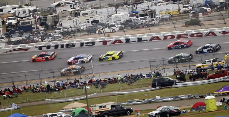 NASCAR racers round the track during the NASCAR Talladega auto race at Talladega Superspeedway, Sunday, May 1, 2016, in Talladega, Ala. (AP Photo/John Bazemore)