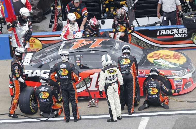 NASCAR driver Ty Dillion, left, gets into NASCAR driver Tony Stewart's, right, car, during the NASCAR Talladega auto race at Talladega Superspeedway, Sunday, May 1, 2016, in Talladega, Ala. (AP Photo/John Bazemore)