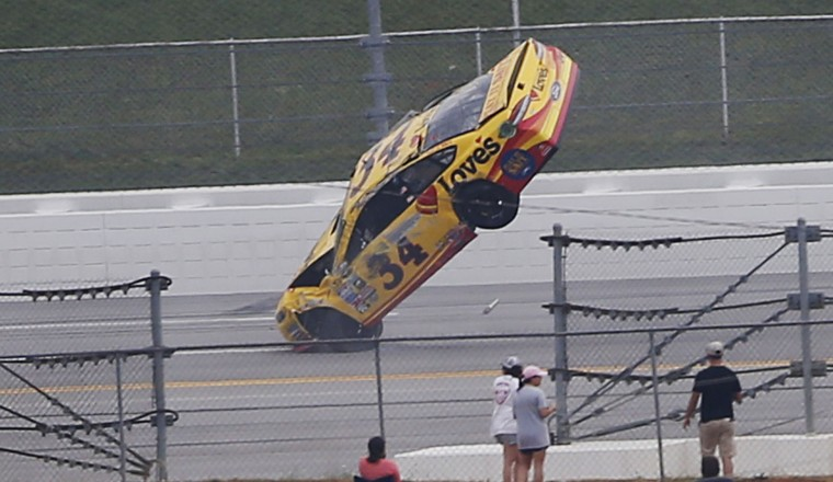 Chris Buescher wrecks during the NASCAR Talladega auto race at Talladega Superspeedway, Sunday, May 1, 2016, in Talladega, Ala. (AP Photo/John Bazemore)