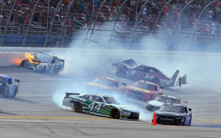 Blake Koch (11) wrecks into Joey Logano (22) right before the finish line during the NASCAR Xfinity Series auto race at Talladega Superspeedway, Saturday, April 30, 2016, in Talladega, Ala. (AP Photo/Jay Alley)