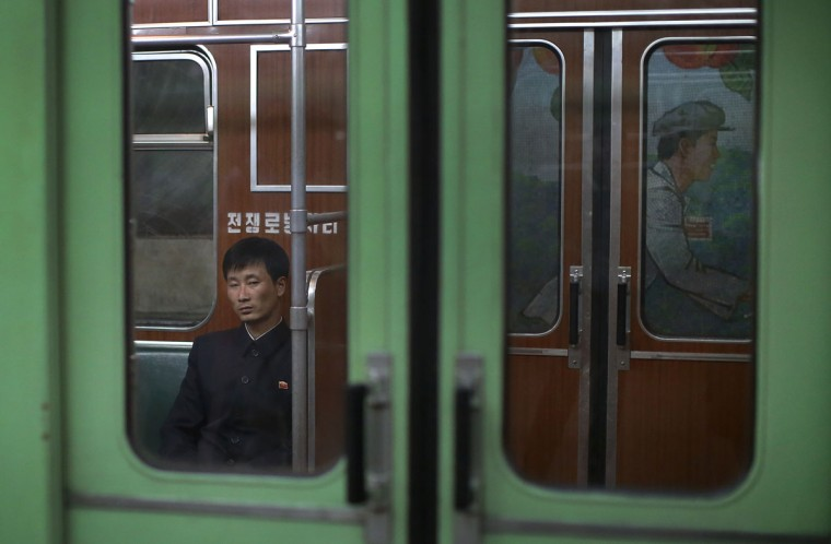 A North Korean man rides in a subway car on Saturday, May 7, 2016, in Pyongyang, North Korea. North Korea's ruling party is preparing to bestow its top title on leader Kim Jong Un, another clear sign that the third heir to North Korea's dynasty of Kims is firmly in control despite his country's deepening international isolation over one of his key ambitions, to keep developing more and better nuclear weapons. (AP Photo/Wong Maye-E)