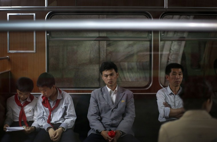 North Korean commuters ride in a subway car on Saturday, May 7, 2016, in Pyongyang, North Korea. North Korea's ruling party is preparing to bestow its top title on leader Kim Jong Un, another clear sign that the third heir to North Korea's dynasty of Kims is firmly in control despite his country's deepening international isolation over one of his key ambitions, to keep developing more and better nuclear weapons. (AP Photo/Wong Maye-E)