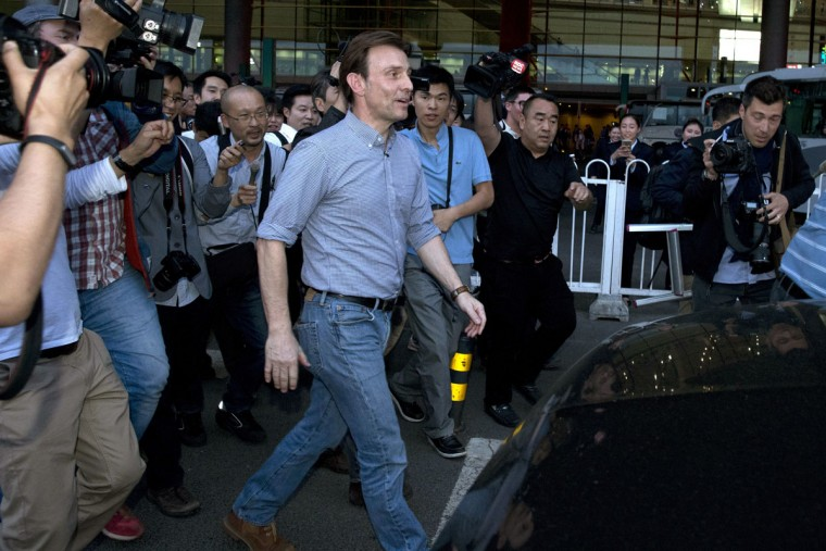BBC's journalist Rupert Wingfield-Hayes, center, walks past journalists as he arrives at the airport in Beijing, China, Monday, May 9, 2016. North Korea on Monday expelled the BBC correspondent, who was not among journalists covering the congress. He had covered an earlier trip of Nobel laureates and had been scheduled to leave Friday. Instead, he was stopped at the airport, detained and questioned. (AP Photo/Ng Han Guan)