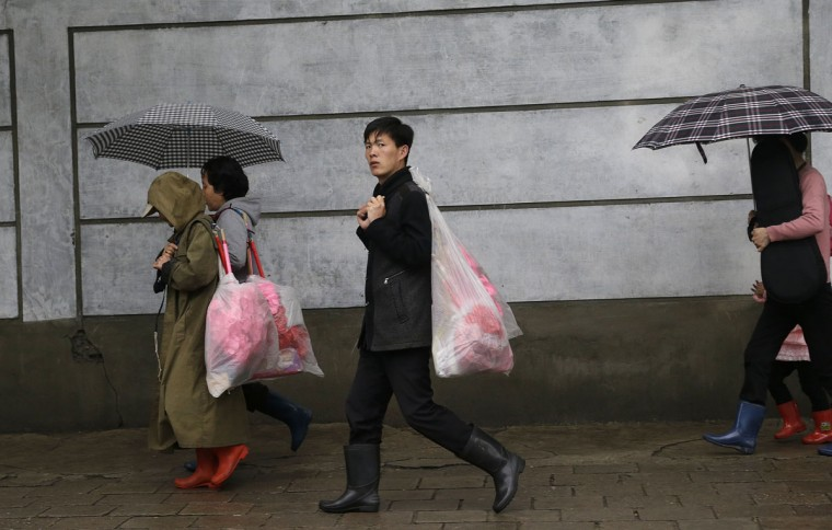 North Koreans carry bouquets of decorative flowers as they make their way towards the Kim Il Sung Square on Friday, May 6, 2016, in Pyongyang, North Korea. North Korea has been duly spruced up, the masses prepped for their rallies and leader Kim Jong Un appears to be set to take center stage Friday when North Korea pulls back the curtain on what promises to be the country's biggest political show in years, if not decades: the first full congress of its ruling party since 1980. (AP Photo/Wong Maye-E)