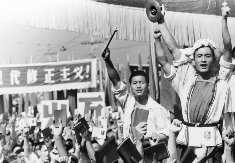 In this file photo taken Aug. 29, 1966, drummers raise their cymbals and sticks as others hold up small booklets containing the writings of then Chairman Mao Zedong during a demonstration by Red Guard youth groups in front of the Soviet Embassy in Beijing. On May 16, 1966, the Communist Party's Politburo produced a document announcing the start of what was formally known as the Great Proletarian Cultural Revolution to pursue class warfare and enlist the population in mass political movements. Launched by leader Mao Zedong, it set off a decade of tumult to revive communist goals and enforce a radical egalitarianism. (AP Photo, File)