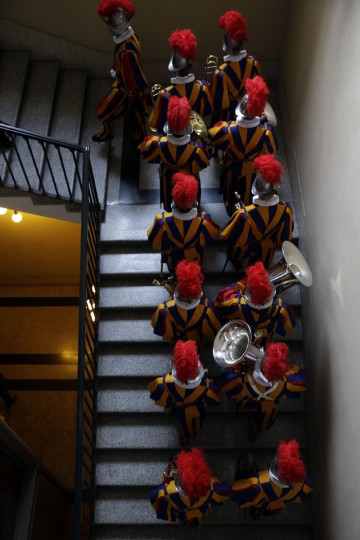 New Vatican Swiss Guards march prior to a swearing-in ceremony, at the Vatican, Friday, May 6, 2016. The ceremony is held each May 6 to commemorate the day in 1527 when 147 Swiss Guards died protecting Pope Clement VII during the Sack of Rome. (AP Photo/Andrew Medichini)