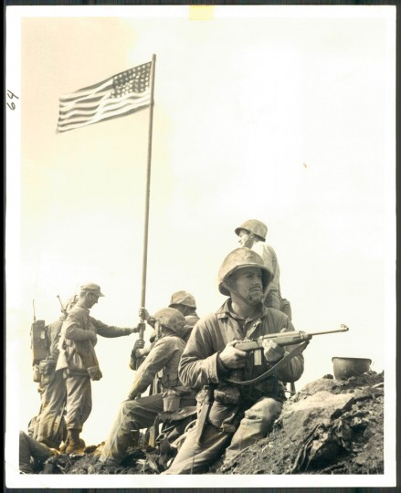 The first flag raised at Iwo Jima.