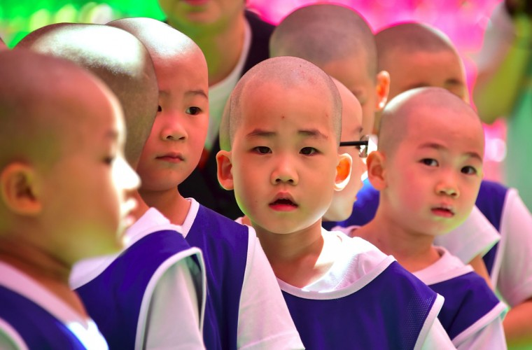 Young South Korean novice monks stand in line to play soccer during their training program entitled 'Children Becoming Buddhist Monks' at the Jogye Temple in Seoul on May 4, 2016. (JUNG YEON-JE/AFP/Getty Images)