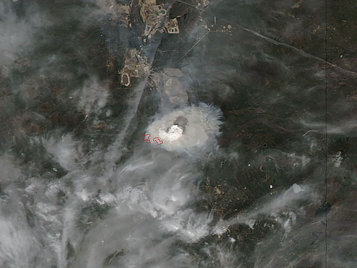 This May 3, 2016 NASA satellite image shows the Fort McMurray wildfire in Alberta, Canada. The 100,000 residents of the Canadian city of Fort McMurray were ordered to leave town late May 3 as a monster wildfire swept through the oil sands region, in Alberta province's largest ever evacuation. No casualties have yet been reported but gas stations exploded and a hotel and one of the town's many motor home parks went up in flames, according to local media. (AFP/Getty Images)