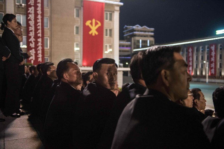 Spectators watch a torchlight parade on Kim Il-Sung square during festivities marking the end of the 7th Workers Party Congress in Pyongyang on May 10, 2016. (ED JONES/AFP/Getty Images)