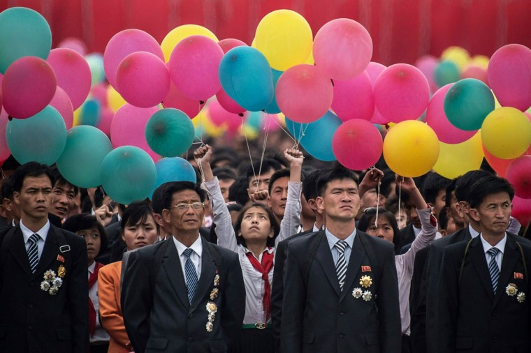 Participants wait to take part in a mass parade marking the end of the 7th Workers Party Congress in Kim Il-Sung square in Pyongyang on May 10, 2016. (ED JONES/AFP/Getty Images)