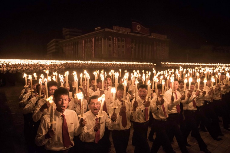 Performers take part in a torchlight parade on Kim Il-Sung square during festivities marking the end of the 7th Workers Party Congress in Pyongyang on May 10, 2016. (ED JONES/AFP/Getty Images)