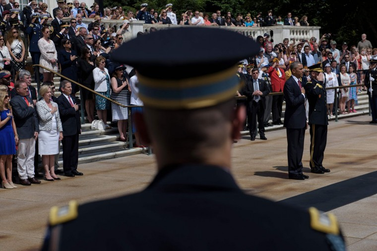 President Barack Obama and Major General Bradley A. Becker, Commander of the Military District of Washington, listen to Taps after placing a wreath at the Tomb of the Unknowns to honor Memorial Day at Arlington National Cemetery May 30, 2016 in Arlington, Virginia. (BRENDAN SMIALOWSKI/AFP/Getty Images)