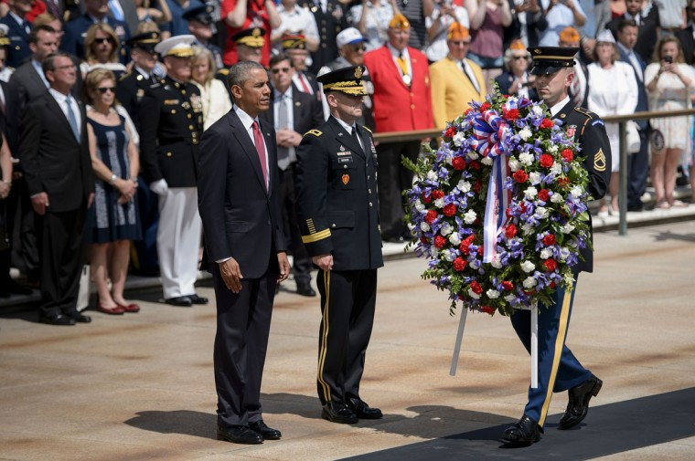 President Barack Obama waits with Major General Bradley A. Becker, Commander of the Military District of Washington, to place a wreath at the Tomb of the Unknowns to honor Memorial Day at Arlington National Cemetery May 30, 2016 in Arlington, Virginia. (BRENDAN SMIALOWSKI/AFP/Getty Images)