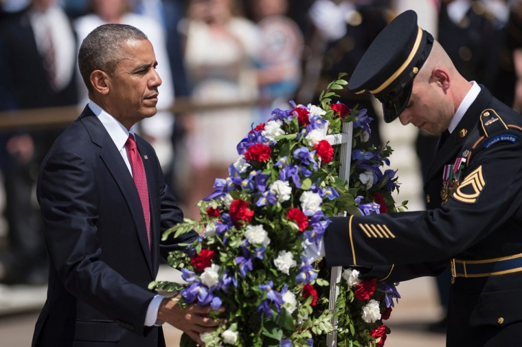 President Barack Obama places a wreath at the Tomb of the Unknowns to honor Memorial Day at Arlington National Cemetery May 30, 2016 in Arlington, Virginia. (BRENDAN SMIALOWSKI/AFP/Getty Images)