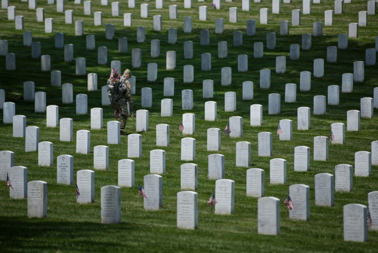 Members of the US Army place American flags at graves at Arlington National Cemetery May 26, 2016 in Arlington, Virginia in preparation for Memorial Day. (BRENDAN SMIALOWSKI/AFP/Getty Images)