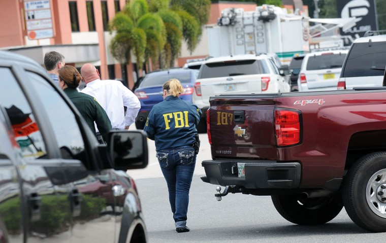 ORLANDO, FLORIDA - JUNE 12: FBI agents seen outside of Pulse nightclub after a fatal shooting and hostage situation where 20 people died on June 12, 2016 in Orlando, Florida. The suspected shooter, Omar Mateen, was shot and killed by police. 50 people are reported dead and 53 were injured in what is now the worst mass shooting in U.S. history. (Photo by Gerardo Mora/Getty Images)