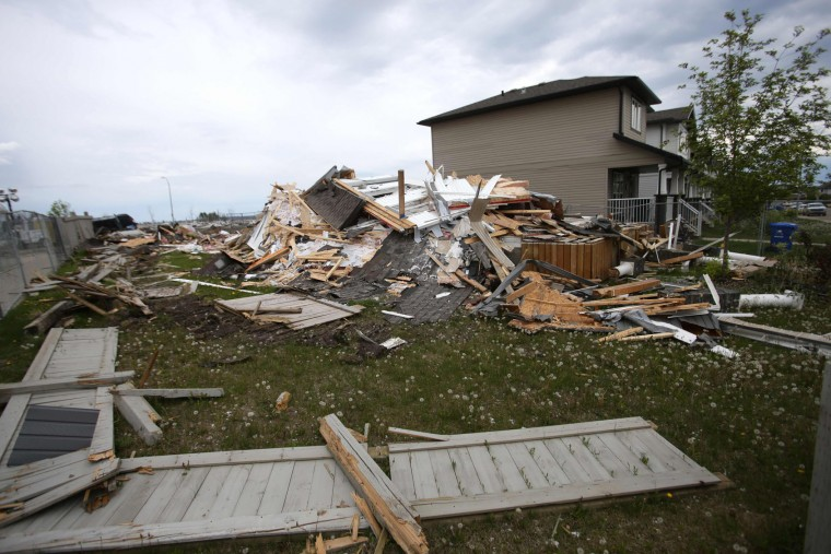 Destroyed homes in the Fort McMurray, Alberta neighbourhood of Timberlea are seen on June 1, 2016. Tens of thousands of Fort McMurray residents were expected to begin trickling back into the Canadian oil city ravaged by wildfires Wednesday after the blaze was declared no longer a threat. (Cole Burston/AFP/Getty Images)