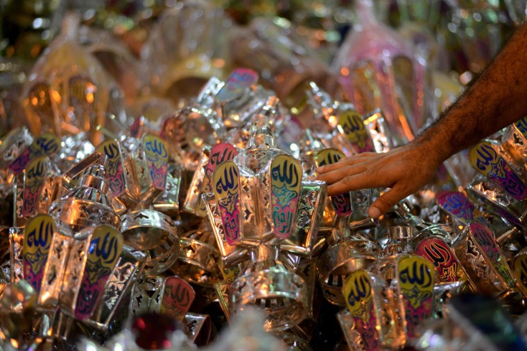 "An Egyptian man selects a traditional lantern known in Arabic as ""Fanous"", sold during the Muslim holy month of Ramadan in the Saida Zeinab district, in the capital Cairo, as the faithful prepare for the start of the holy month, on May 29, 2016. More than 1.5 billion Muslims around the world will mark the holy month which begins this week. Ramadan is the ninth month of the Muslim lunar calendar during which observant Muslims fast from dusk to dawn. / (AFP Photo/Mohamed El-shahed)"