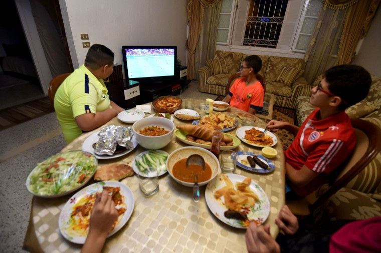 A Tunisian family watches a Euro 2016 football match during the break of Ramadan fast on June 17, 2016 in Tunis. (Fethi Belaid/AFP/Getty Images)