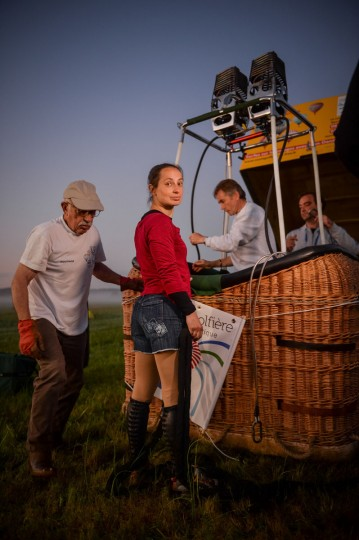French trapeze artist Isabelle Ponsot prepares before taking off to perform while hanging from a hot air balloon in Chatellerault on June 22, 2016. (GUILLAUME SOUVANT/AFP/Getty Images)