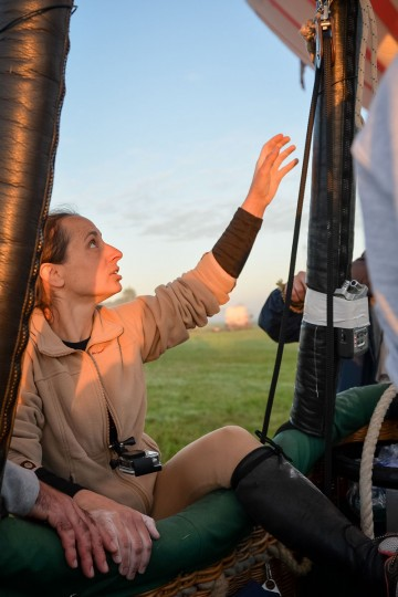 French trapeze artist Isabelle Ponsot gets into a hot air ballon before taking off to perform while hanging from the balloon in Chatellerault on June 22, 2016. (GUILLAUME SOUVANT/AFP/Getty Images)