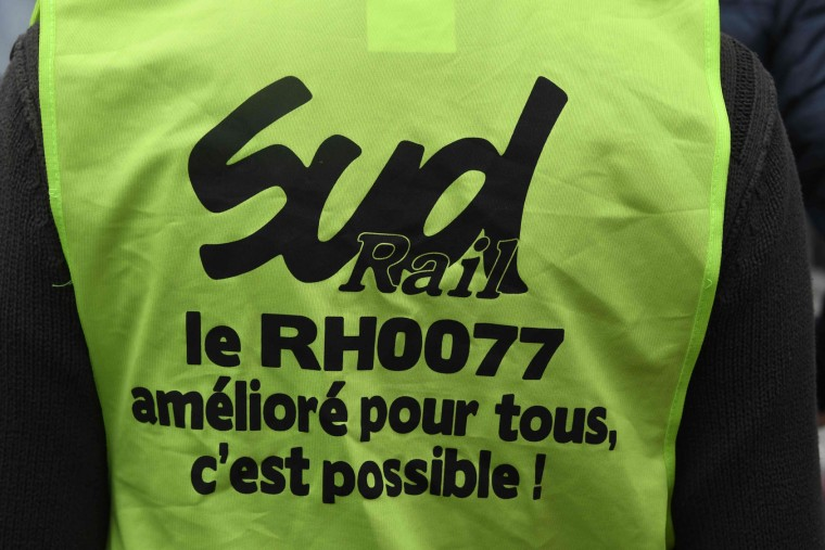 "This picture taken on June 2, 2016, shows a railway workers' union vest reading ""Sud rail, working hours decree improved for all, it's possible"" attends a rally against the government's labour market reforms in Rennes, northwestern France, on June 2, 2016. Thousands took to the streets across the country on Thursday in the latest demonstrations against the labour law reforms, which the government says are designed to make France more business-friendly. In Rennes, the police charged the protesters with the help of vehicles, leaving several injured. (Damien Meyer/AFP/Getty Images)"