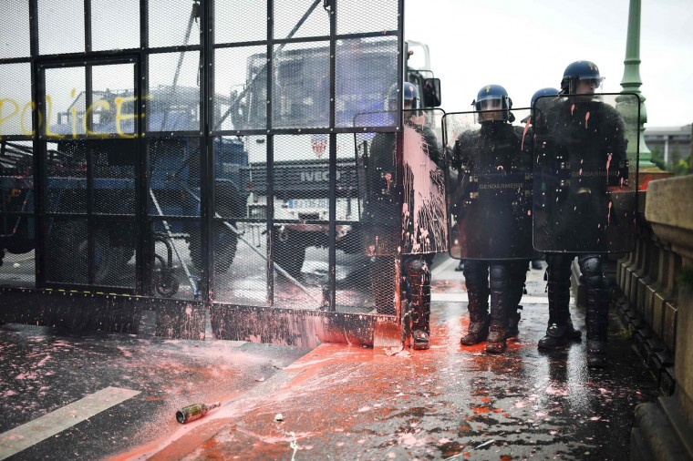 French riot police officers received pink paint during clashes with protesters during a demonstration against the government's labour market reforms on June 2, 2016 in Nantes, western France. More demonstrations against the reforms which the government says are designed to make France more business-friendly -- were set to take place in major cities on June 2 and nuclear power workers were back on strike at 16 of the country's 19 power stations. (Jean-Sebastien Evrard/AFP/Getty Images)